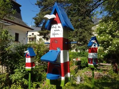 """Vogelhaus Futterhaus """"Auf zu neuen Ufern"""" Leuchtturm - personalisiert"""